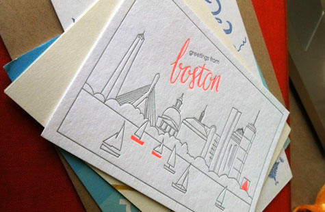 'Greetings from boston' letterpressed design of the city.