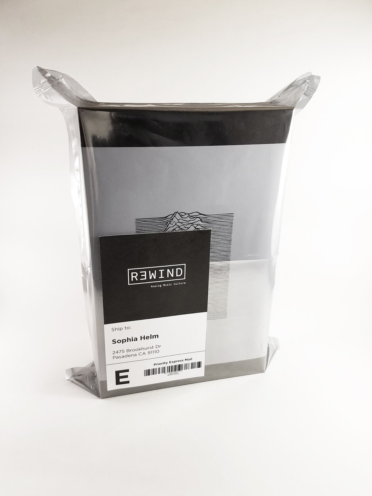 Shipping bag with rewind subscription box packaging.