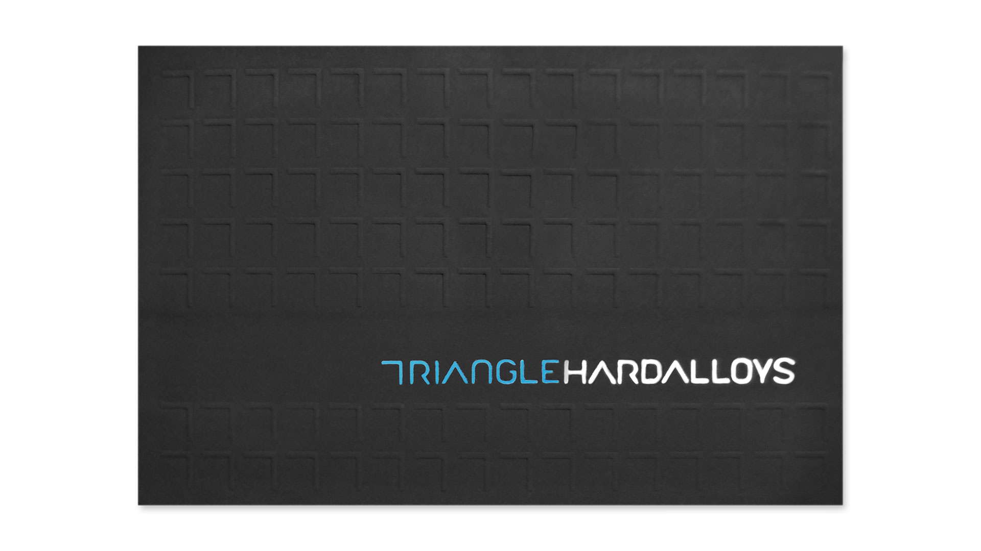 Triangle hard alloys business card designed by burdgecooper 1000 printing method foil stamp blind emboss number of colors 2 colors blue silver foils finishing and binding double thick gilded edging colourmoves