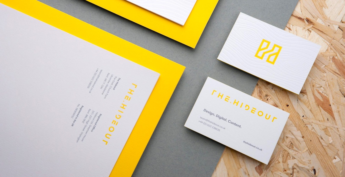 The Hideout White Foil on White Paper Business Card