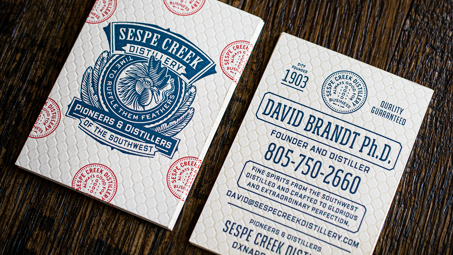 Good example of letterpress and debossing techniques on business cards from Sespe Creek Distillery designed by Chad Michael Studio