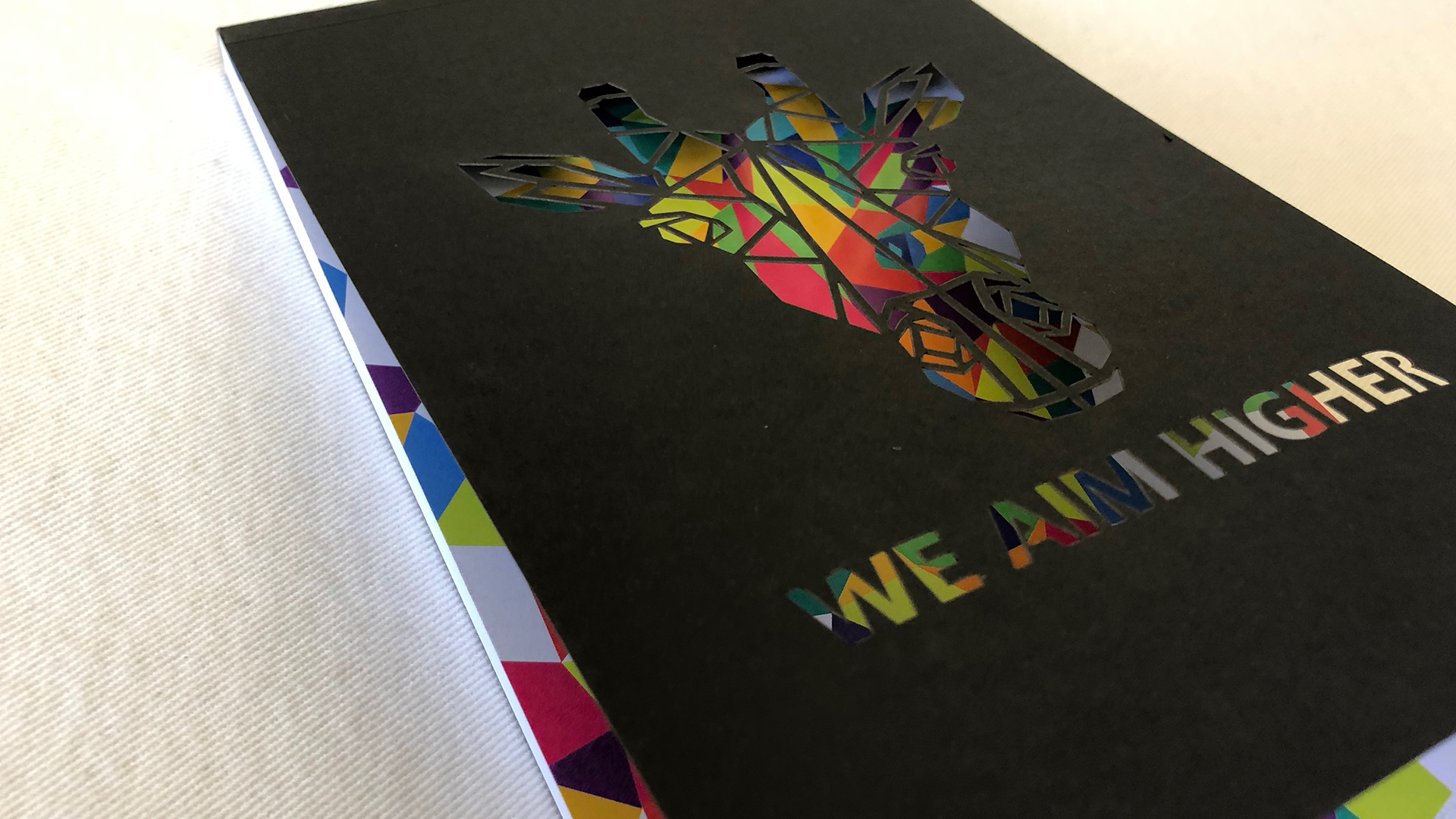 Vibrant 'We Aim Higher' Notebook - PaperSpecs